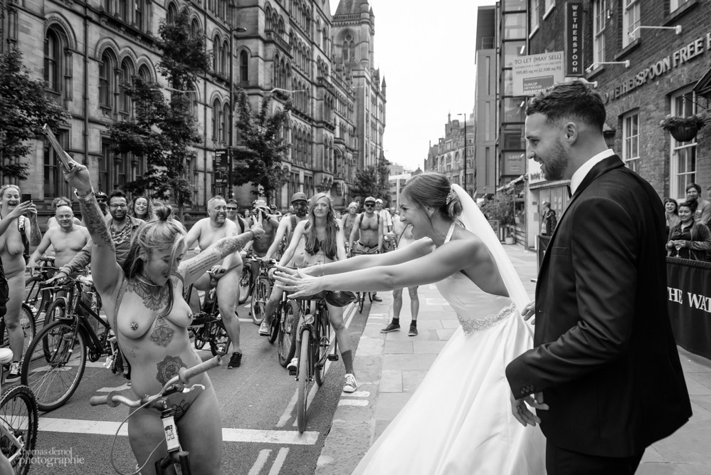 A bride finds her hairdresser at the Naked Bike Ride in Manchester