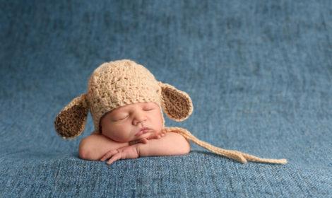 Newborn baby with lamb hat