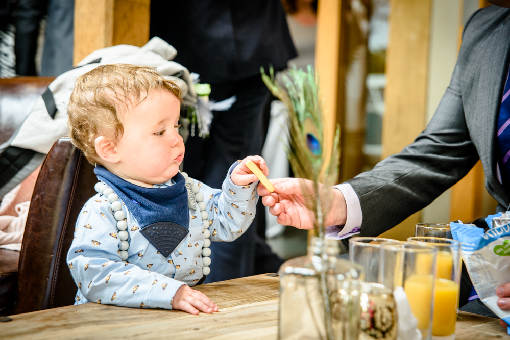 Toddler tasting something during the drink reception