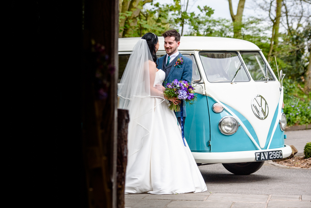 Bride and groom in front of camper van outside Oak Tree of Peover