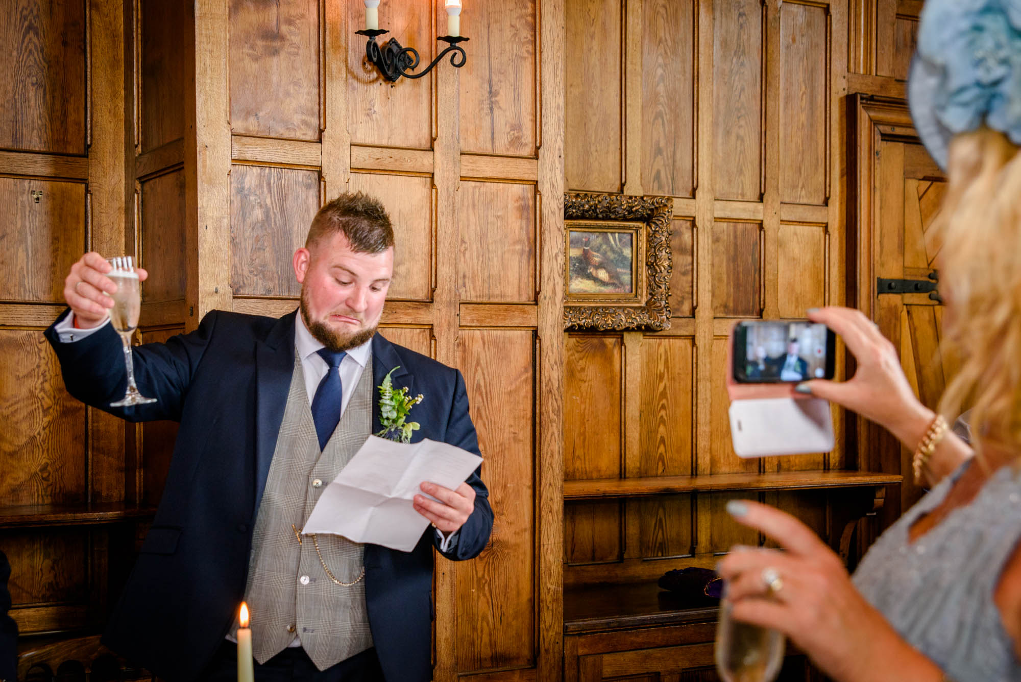 Bestman pulling a face as he doesn't know who to toast for