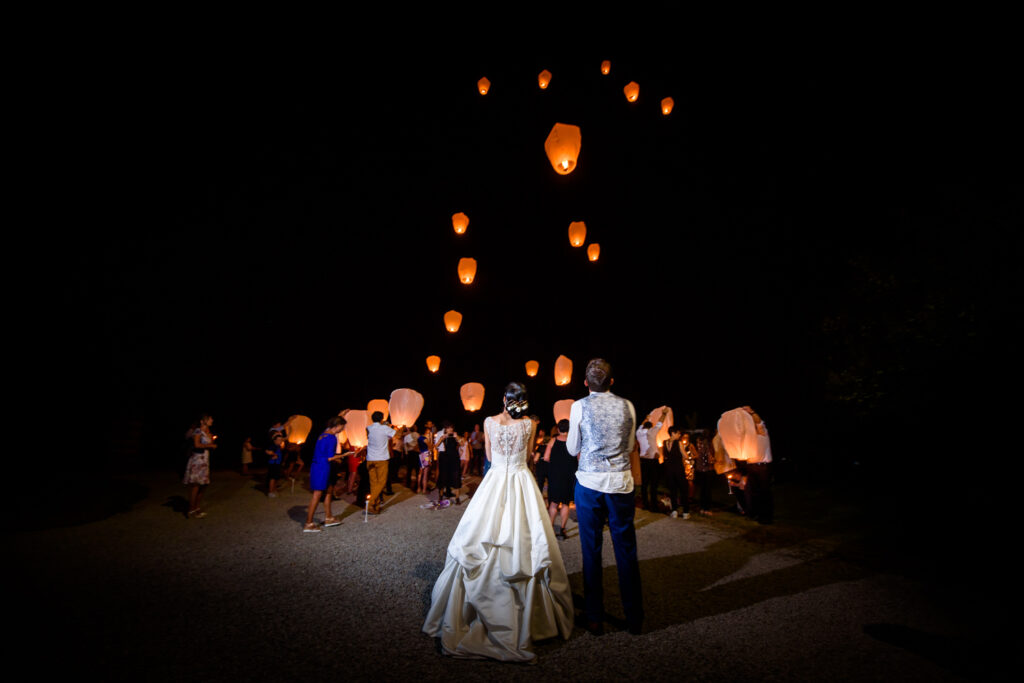 bride and groom watching the lantern launch