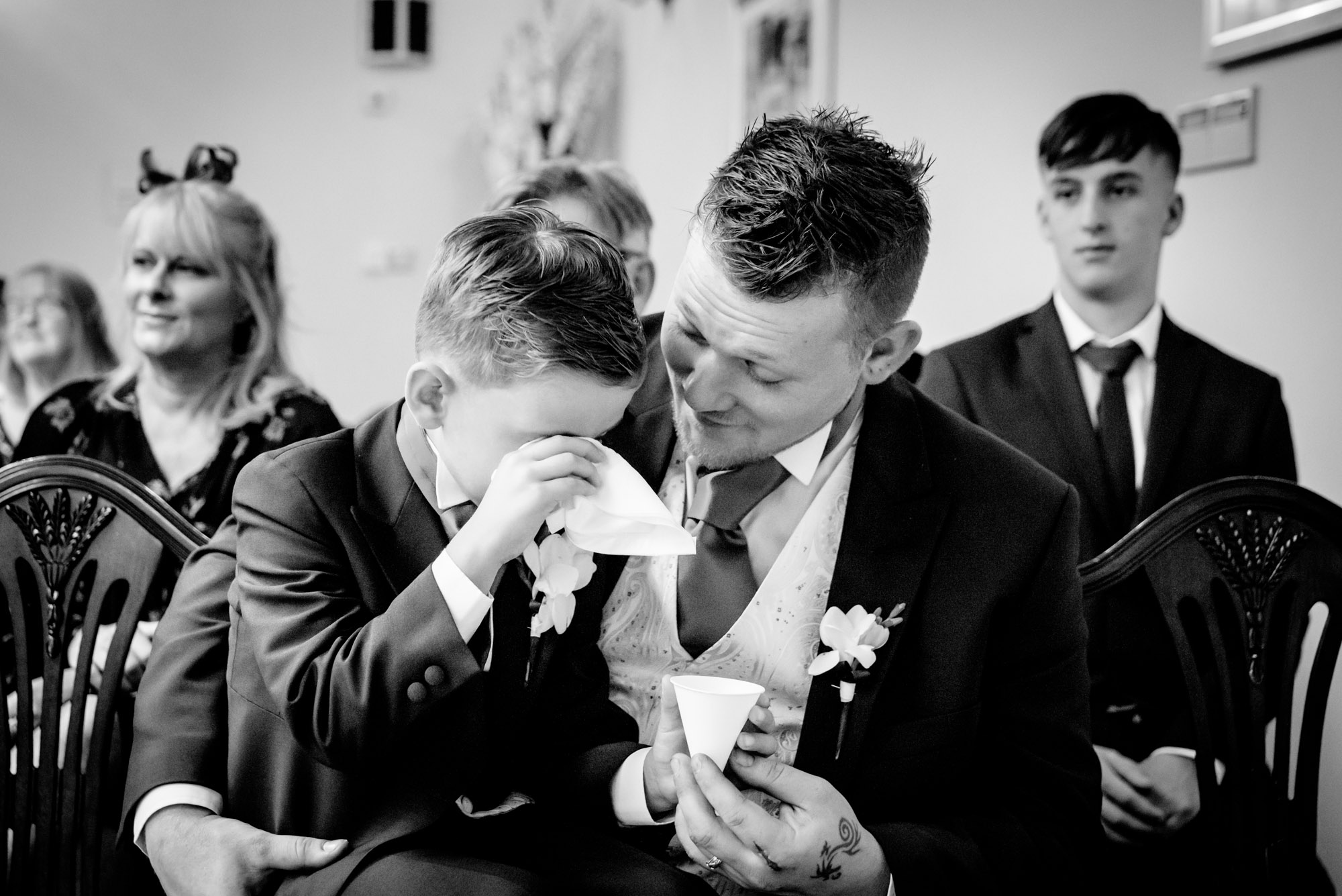 Bride's son getting emotional during the ceremony