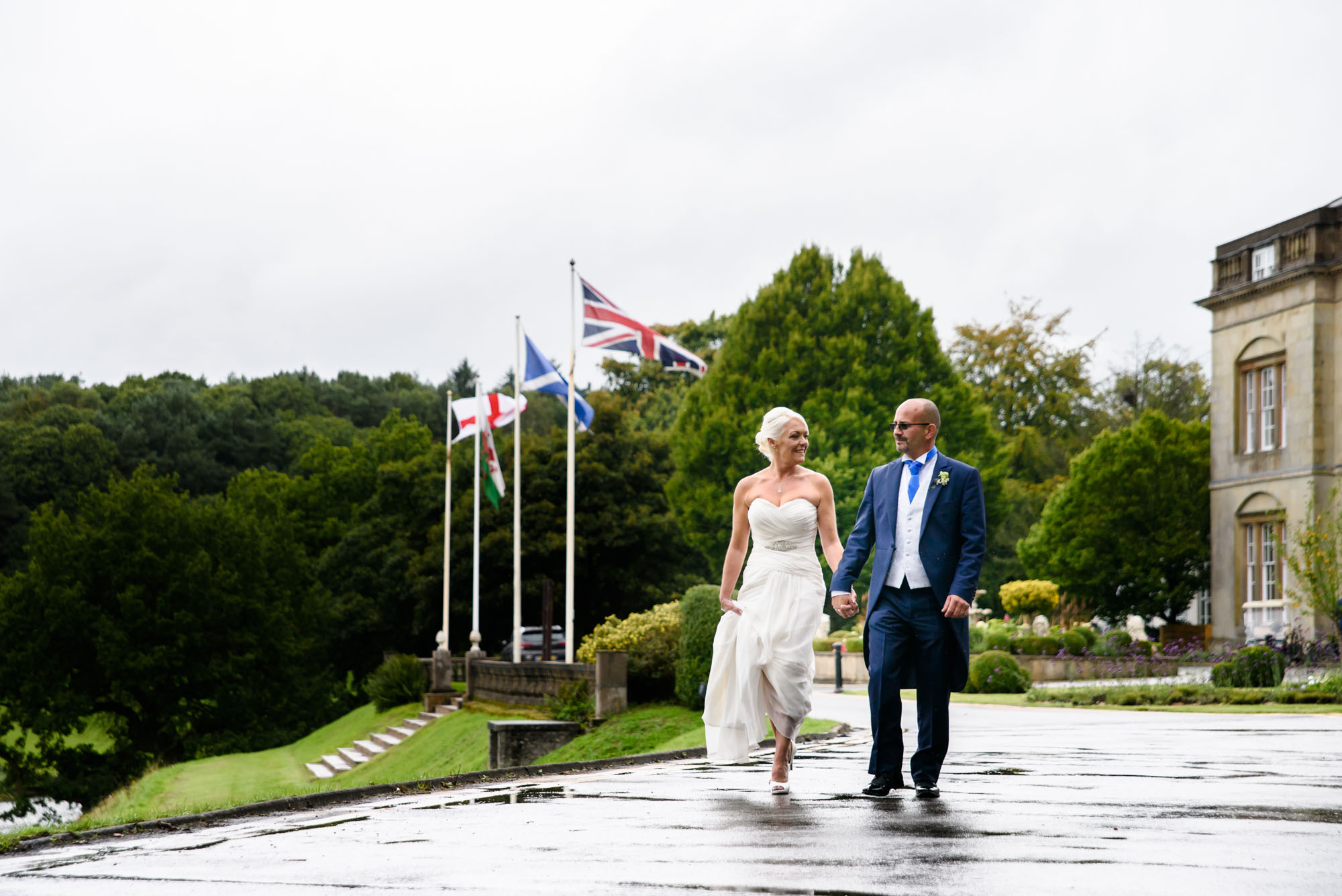 Bride and groom going for a walk around Shrigley Hall
