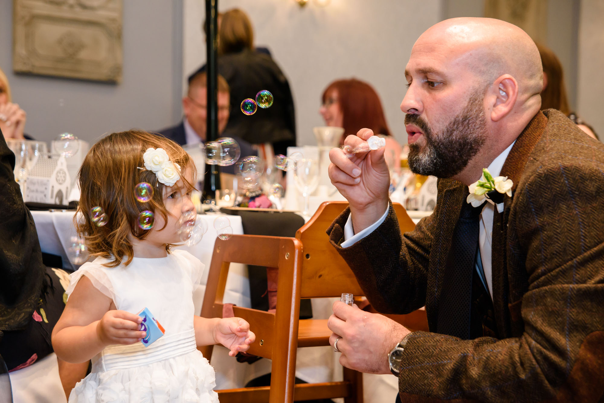 Flower girl playing with bubbles