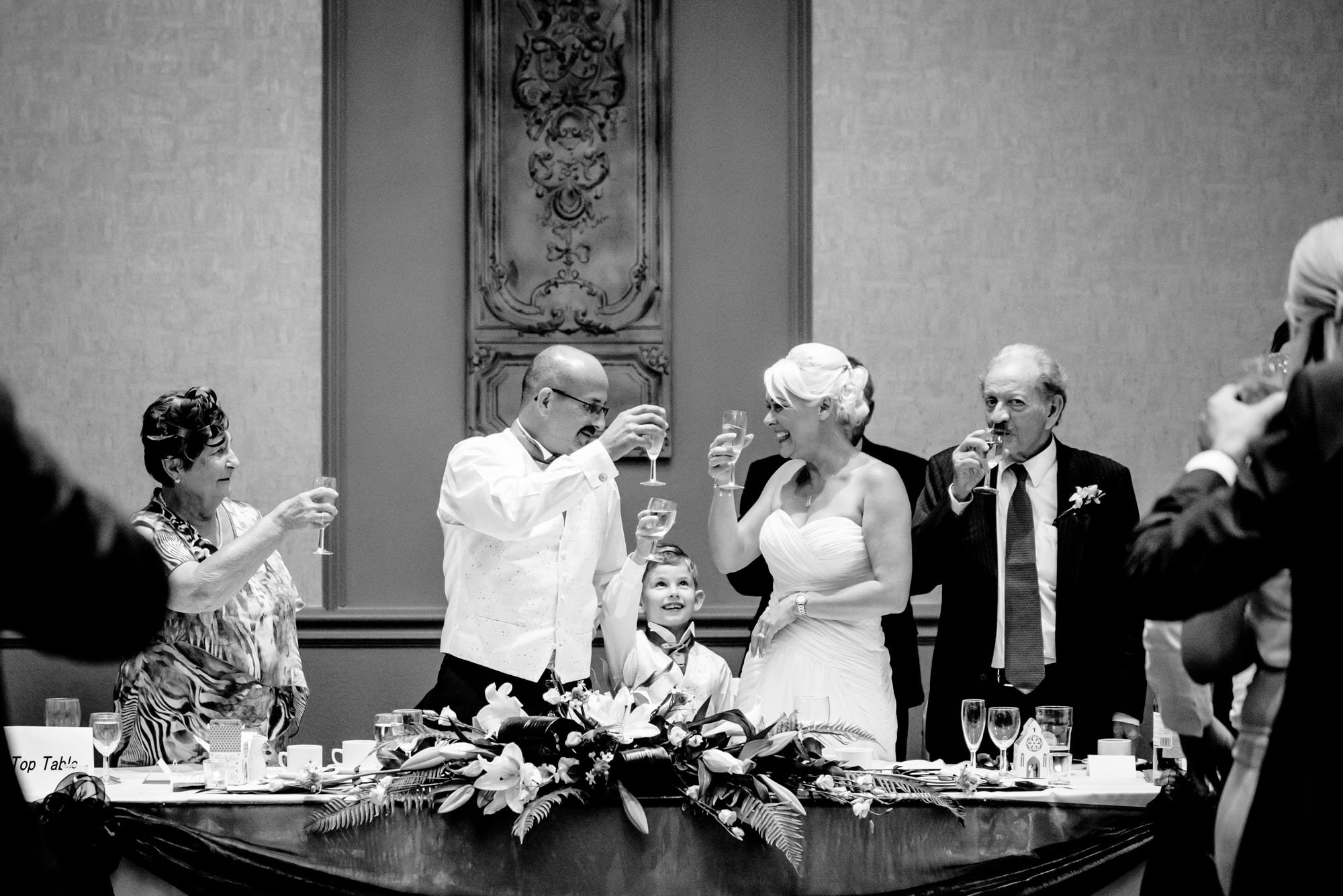 Bride and groom toasting with son