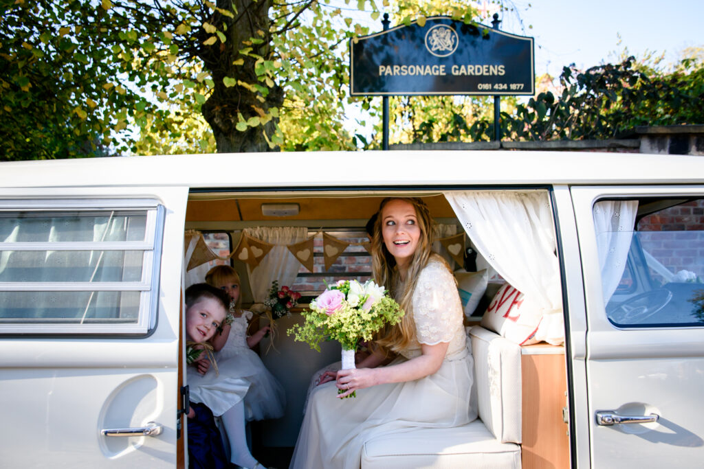 Bride arriving in VW campervan