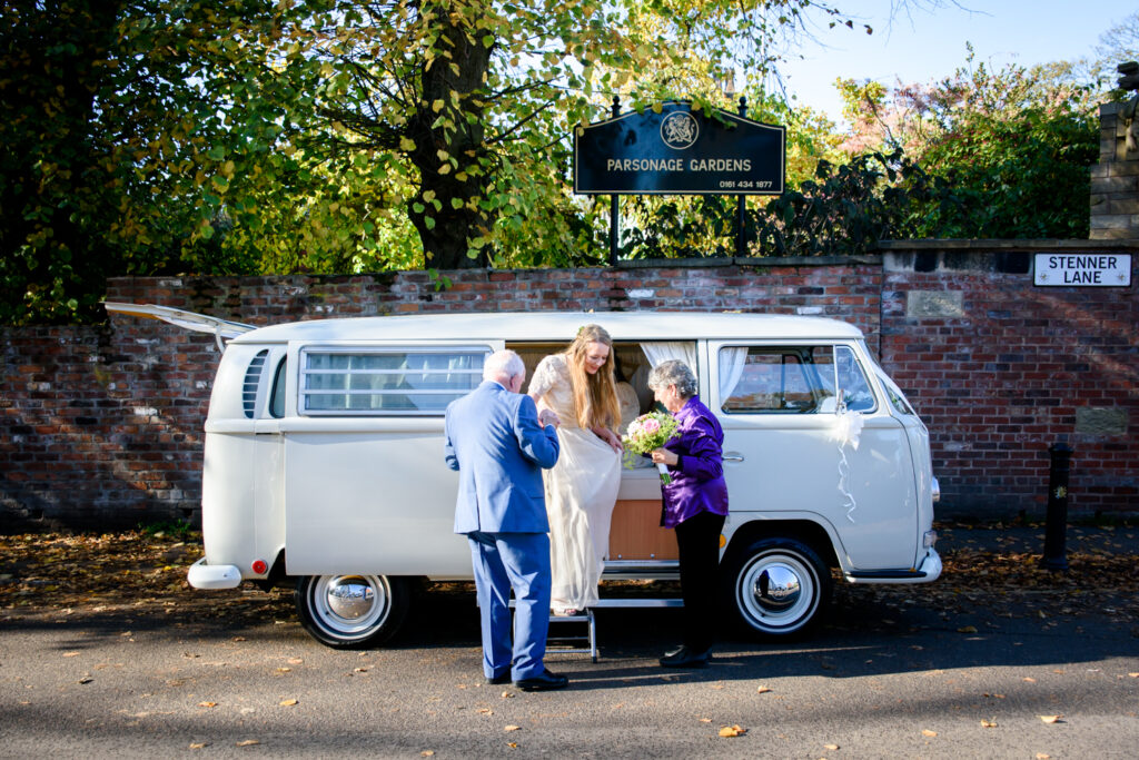 Bride arriving in VW campervan at Didsbury Parsonage