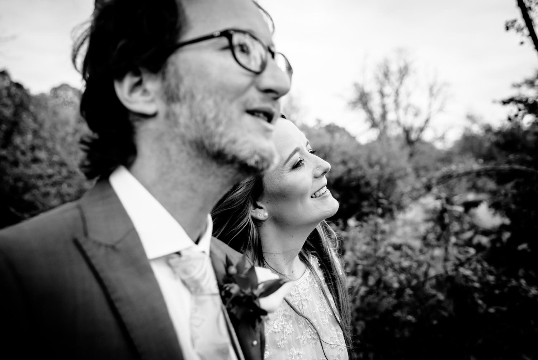 Bride and groom walking around Fletcher Moss park